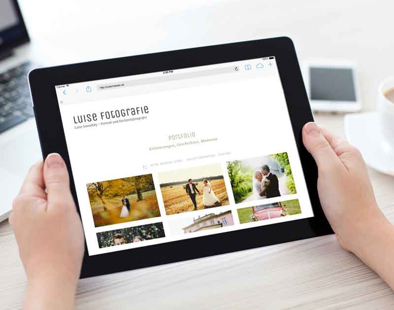 iPad-in-Hand-Mockup-luise